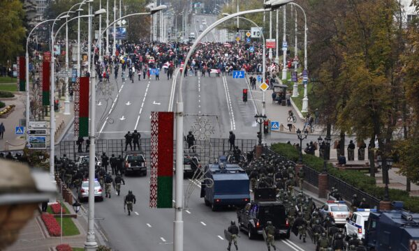 Belarusian law enforcement officers and service members block a street