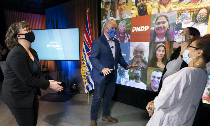 NDP Leader John Horgan tells a joke following a virtual campaign event in downtown Vancouver on Oct. 22, 2020.  (The Canadian PressT/Jonathan Hayward)