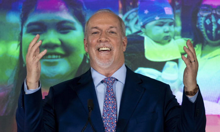 NDP Leader John Horgan celebrates his election win in the BC provincial election in downtown Vancouver on Oct. 24, 2020. (The Canadian Press/Jonathan Hayward)