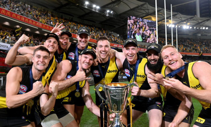 The Tigers players celebrate victory after the 2020 AFL Grand Final match between the Richmond Tigers and the Geelong Cats at The Gabbain, Brisbane, Australia on Oct. 24, 2020. (Bradley Kanaris/AFL Photos/via Getty Images)