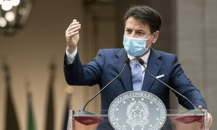 Italian Premier Giuseppe Conte announces new rules to curb the spread of COVID-19, in Rome, on Oct. 25, 2020. (Roberto Monaldo/LaPresse via AP)