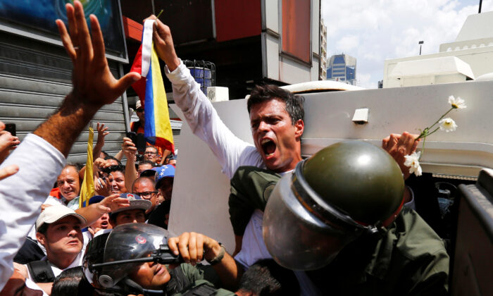 Venezuelan opposition leader Leopoldo Lopez gets into a National Guard armored vehicle in Caracas, on Feb. 18, 2014. (Jorge Silva/Reuters)