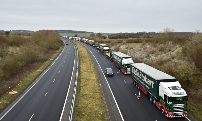 Lorries are held in a formation as they take part in a trial to tackle potential post-Brexit traffic queues, on the A256 a few miles north of Dover in southern England, on Jan. 7, 2019. (Glyn Kirk/AFP via Getty Images)