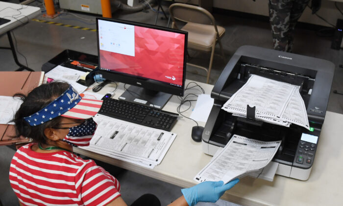 A Clark County election worker scans mail-in ballots at the Clark County Election Department in North Las Vegas, Nev., on Oct. 20, 2020. (Ethan Miller/Getty Images)
