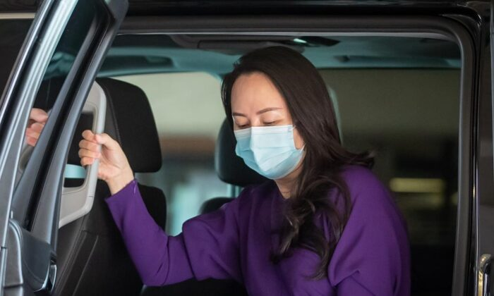 Meng Wanzhou, chief financial officer of Huawei, wears a face mask to curb the spread of the CCP virus COVID-19 as she arrives at B.C. Supreme Court to attend a hearing in Vancouver, on, Sept. 29, 2020. (The Canadian Press/Darryl Dyck)