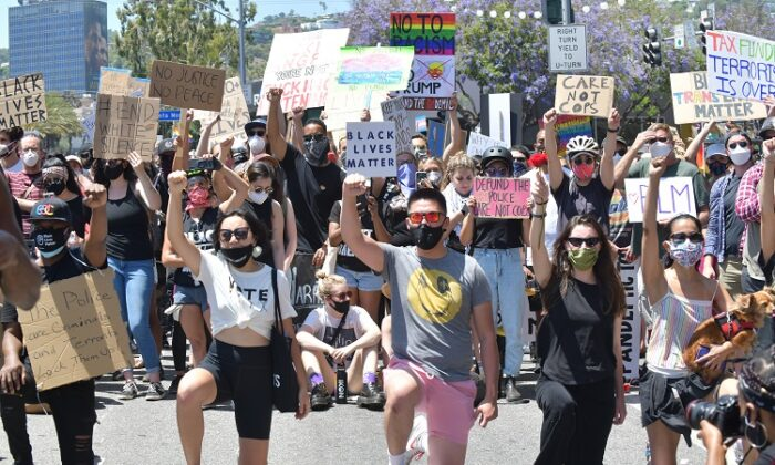 Marchers kneel in solidarity for eight minutes and 46 seconds in honor of George Floyd during the All Black Lives Matter Solidarity March in Los Angeles on June 14, 2020. (Rodin Eckenroth/Getty Images)