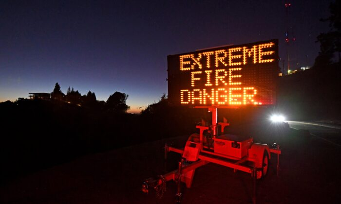A roadside sign warns motorists of extreme fire danger on Grizzly Peak Boulevard, in Oakland, Calif., on Oct. 25, 2020. (Jose Carlos Fajardo/Bay Area News Group via AP)
