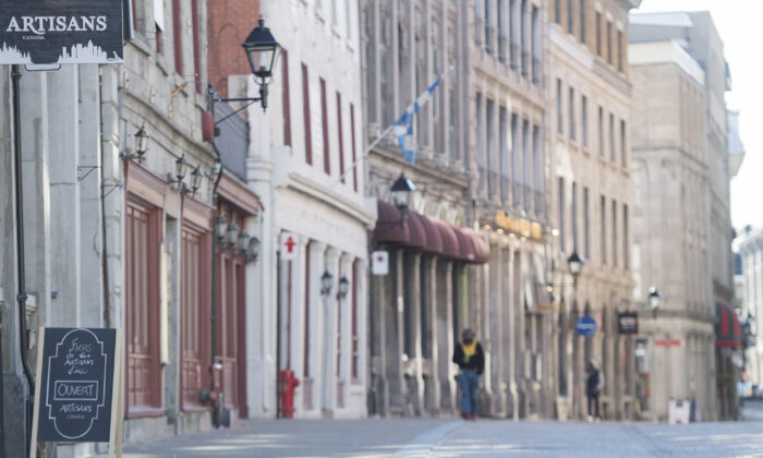 An almost empty street in Old Montreal on Oct. 25, 2020. (The Canadian Press/Graham Hughes)