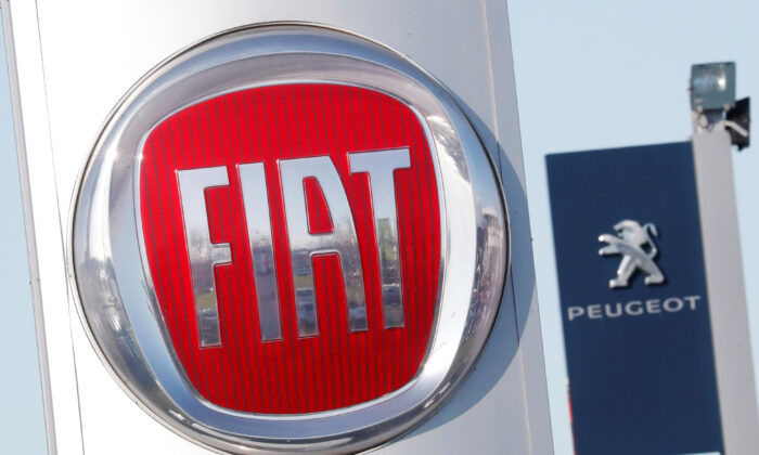 The logos of car manufacturers Fiat and Peugeot are seen in front of dealerships of the companies in Saint-Nazaire, France, on Nov. 8, 2019. (Stephane Mahe/Reuters)