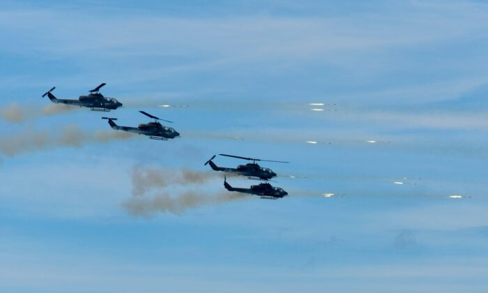 "Four US-made AH-1W SuperCobras attack helicopters launch rockets during the 35th ""Han Kuang"" military drill in southern Taiwan's Pingtung county on May 30, 2019.  (Sam Yeh/AFP via Getty Images)"