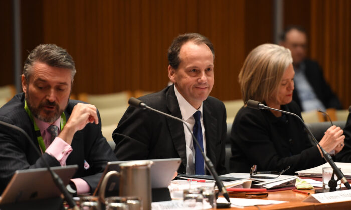 Deputy Chair Daniel Crennan (L) and Chair James Shipton (C) from the Australian Securities and Investments Commission (ASIC) appears during a public hearing in front of the Parliamentary Joint Committee on September 13, 2019 in Canberra, Australia. (Tracey Nearmy/Getty Images)
