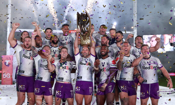 Cameron Smith of the Storm holds aloft the Premiership trophy and celebrates with teammates after winning the 2020 NRL Grand Final match between the Penrith Panthers and the Melbourne Storm at ANZ Stadium on October 25, 2020 in Sydney, Australia. (Cameron Spencer/Getty Images)