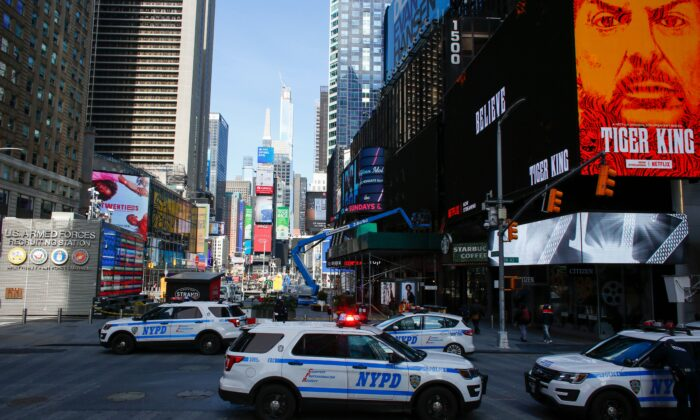 NYPD cars are seen in Times Square in New York City, on March 22, 2020. (Kena Betancur /AFP via Getty Images)