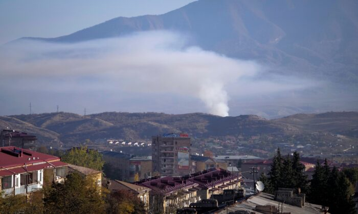 Smoke rises after shelling by Azerbaijan's artillery during a military conflict in Stepanakert, the separatist region of Nagorno-Karabakh, on Oct. 24, 2020. (AP Photo)
