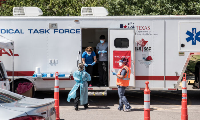 Nurses conduct CCP virus testing at a newly opened drive-thru site on July 21, 2020 in El Paso, Texas. (Cengiz Yar/Getty Images)