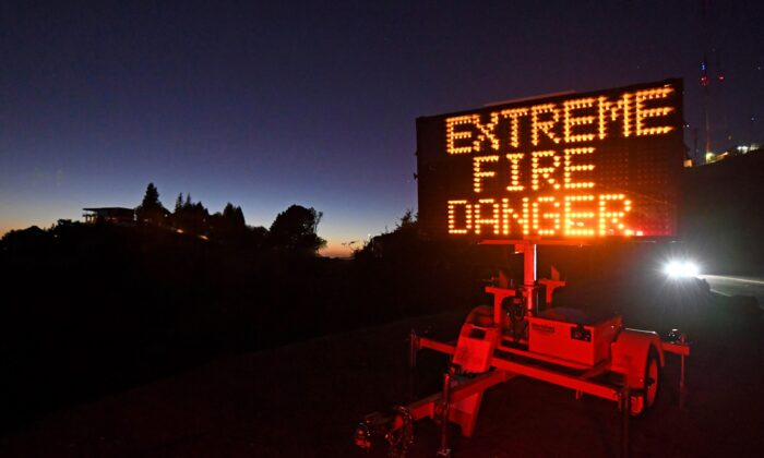 A roadside sign warns motorists of extreme fire danger on Grizzly Peak Boulevard, in Oakland, Calif., on Oct. 25, 2020. (Jose Carlos Fajardo/Bay Area News Group via AP)