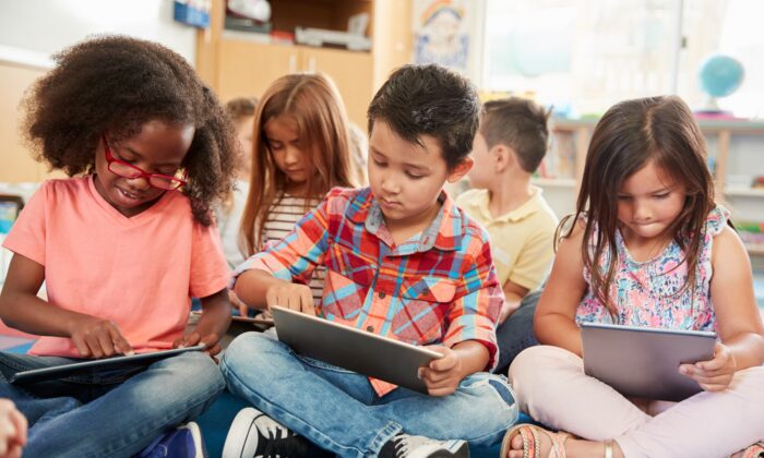 Children are being directed toward devices for their education in environments saturated with dangerous radiation from commercial Wi-Fi networks. (Monkey Business Images/Shutterstock)