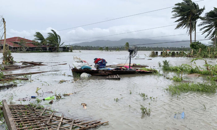 The remains of a house is surrounded by floods in Pola town on the island of Mindoro, central Philippines, on Oct. 26, 2020. (Erik De Castro/ AP Photo)