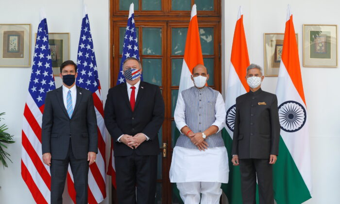 U.S. Secretary of State Mike Pompeo, U.S. Secretary of Defense Mark Esper pose for a picture with India's Foreign Minister Subrahmanyam Jaishankar and India's Defence Minister Rajnath Singh during a photo opportunity ahead of their meeting at Hyderabad House in New Delhi, India, October 27, 2020. (Adnan Abidi/Reuters/Pool)