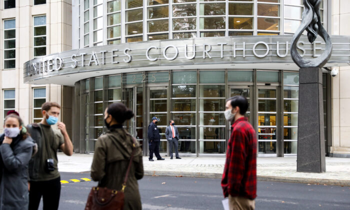 Reporters and photographers are waiting outside of U.S. District Court for the Eastern District of New York on Oct. 27, 2020. (Chung I Ho/The Epoch Times)