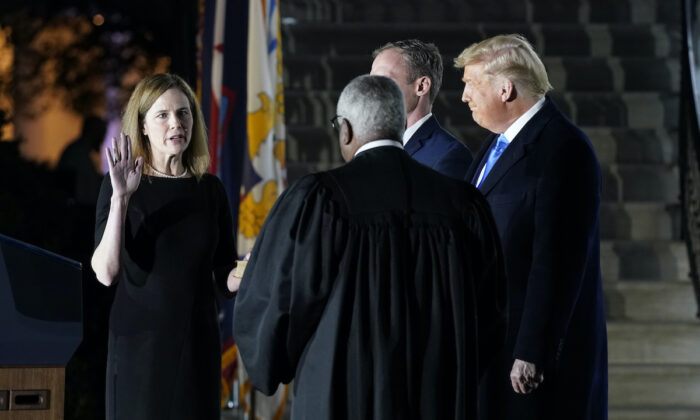 President Donald Trump watches as Supreme Court Justice Clarence Thomas administers the Constitutional Oath to Amy Coney Barrett on the South Lawn of the White House in Washington on Oct. 26, 2020. (Patrick Semansky/AP Photo)