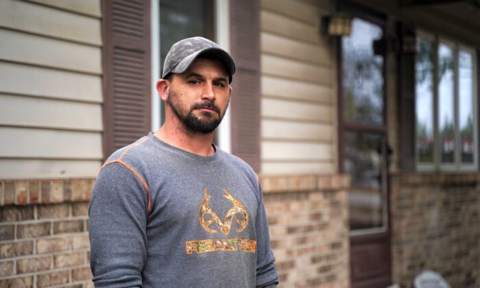 Bobby Tisdell stands in front of his home in West Terre Haute, Vigo County, Ind., on Oct. 20, 2020. (Cara Ding/The Epoch Times)