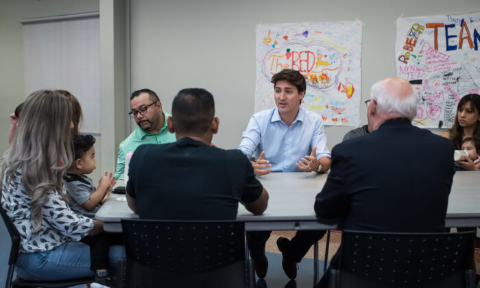 Prime Minister Justin Trudeau sits down to speak with families about the Canada Child Benefit during a visit to the Surrey Sport and Leisure Complex, in Surrey, B.C., on July 13, 2019. (The Canadian Press/Darryl Dyck)