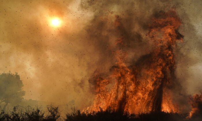 The Silverado Fire burns along the 241 State Highway on Oct. 26, 2020, in Irvine, Calif. (Jae C. Hong/AP Photo)
