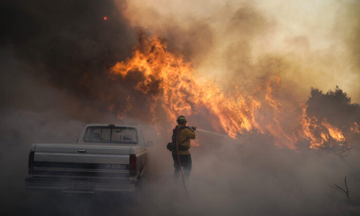 Firefighter Raymond Vasquez battles the Silverado Fire in Irvine, Calif., on Oct. 26, 2020. (Jae C. Hong/AP Photo)