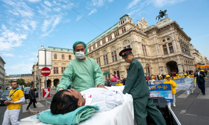 Falun Gong practitioners in Vienna, Austria, stage a demonstration of organ harvesting of imprisoned practitioners in China during  a protest against 