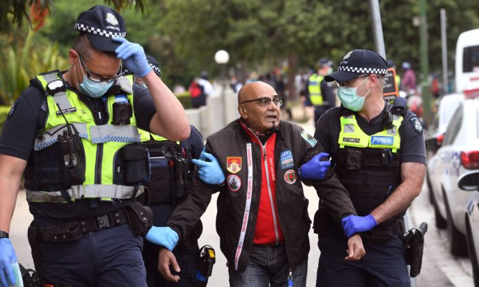 Police arrest a protester during an anti-lockdown rally in Melbourne on Oct. 23, 2020, amid the Covid-19 coronavirus pandemic. (William West / AFP via Getty Images)