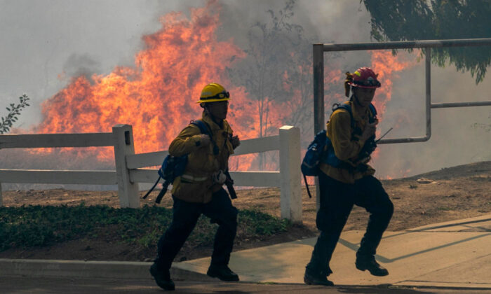 Firefighters react to approaching flames at the Blue Ridge Fire in Yorba Linda, Calif., on Oct. 27, 2020. (David McNew/Getty Images)
