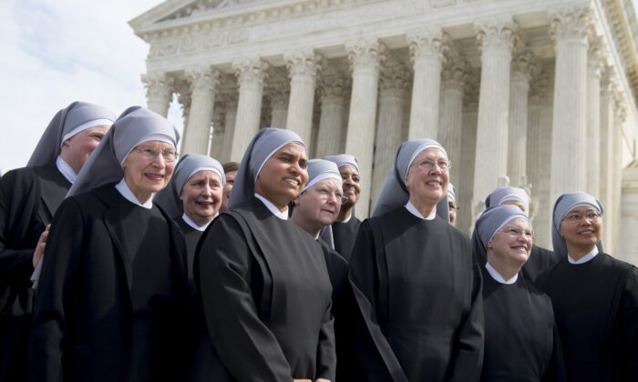 Members of the Little Sisters of the Poor stand outside the Supreme Court following oral arguments in seven cases dealing with religious organizations that want to ban contraceptives from their health insurance policies on religious grounds in Washington on March 23, 2016. (Saul Loeb/AFP via Getty Images)