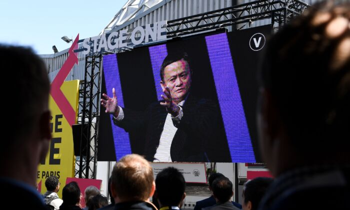 People watch on a giant screen set outside the venue at the Paris Expo of Portes de Versaille, Chinese Alibaba group CEO Jack Ma speaking during the Vivatech startups and innovation fair, in Paris on May 16, 2019. (ALAIN JOCARD/AFP via Getty Images)
