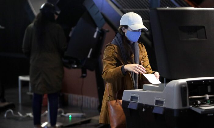 A voter casts her ballot at an early voting center at Nationals Park in Washington, D.C., on Oct. 27, 2020. (Alex Wong/Getty Images)