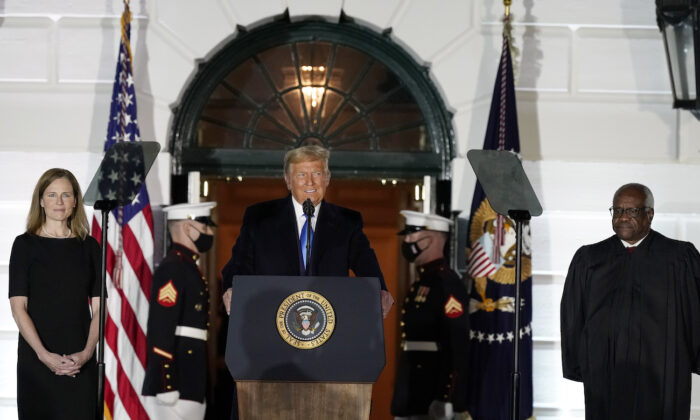 President Donald Trump speaks before Supreme Court Justice Clarence Thomas administers the Constitutional Oath to Amy Coney Barrett on the South Lawn of the White House in Washington, Oct. 26, 2020. (AP Photo/Alex Brandon)