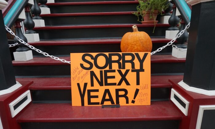 A sign reads 'Sorry next year' on steps outside a home in this file photo. Due to restrictions to slow the spread of the CCP virus, many children will not be able to participate in trick or treating this Halloween. (Ben Shan/Unsplash.com)