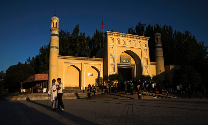Ethnic Uyghur men leave prayers marking Eid Al Fitr outside Id Kah Mosque in the old town of Kashgar, in the far western Xinjiang region, China, on June 26, 2017. (Kevin Frayer/Getty Images)