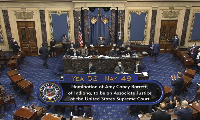 In this image from video, the vote total in the U.S. Senate on the confirmation of Amy Coney Barrett to become a Supreme Court justice at the U.S. Capitol in Washington, on Oct. 26, 2020. (Senate Television via AP)