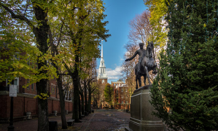 A statue of Paul Revere stands in front of Old North Church. (Diego Grandi/Shutterstock)