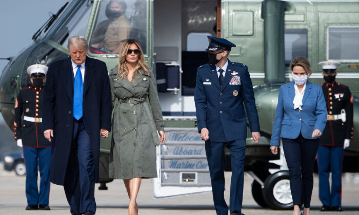 First Lady Melania Trump walks President Donald Trump to Air Force One at Andrews Air Force Base, in Md., on Oct. 27, 2020. (Brendan Smialowski/AFP via Getty Images)