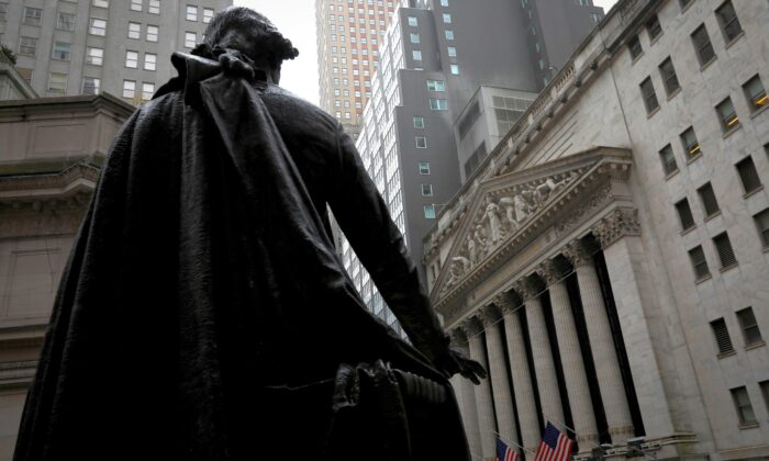 A statue of George Washington stands as Federal Hall across Wall Street from the New York Stock Exchange in Manhattan in New York City, N.Y., on Oct. 26, 2020. (Mike Segar/Reuters)