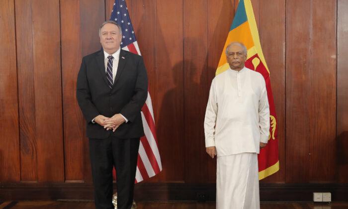 U.S. Secretary of State Mike Pompeo and Sri Lankan Foreign Minister Dinesh Gunawardena stand for photographs before their meeting in Colombo, Sri Lanka, Oct. 28, 2020. (Eranga Jayawardena,  Pool/AP Photo)