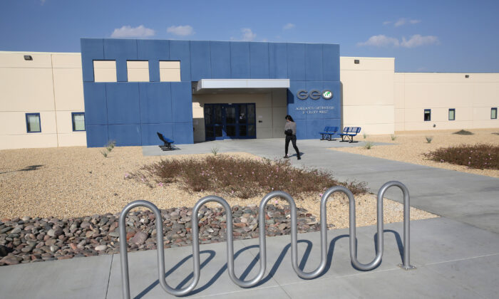 A family member walks into the Adelanto Detention Facility, in Adelanto, Calif., on Nov. 15, 2013. (John Moore/Getty Images)