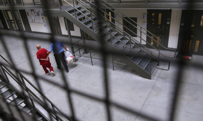A guard escorts a detainee back into the general population at the Adelanto Detention Facility, in Adelanto, Calif., on Nov. 15, 2013. (John Moore/Getty Images)