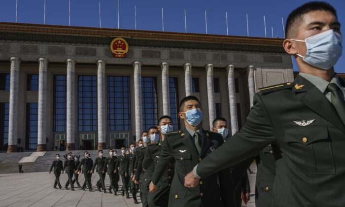 Chinese soldiers march in front of the Great Hall of the People in Beijing, China on Oct. 23, 2020. (Kevin Frayer/Getty Images)