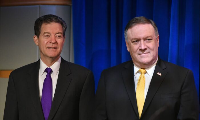 US Secretary of State Mike Pompeo (R) and Ambassador at Large for International Religious Freedom Sam Brownback are introduced during the release of the 2017 Annual Report on International Religious Freedom in Washington, on May 29, 2018. (Mandel Ngan/AFP via Getty Images)