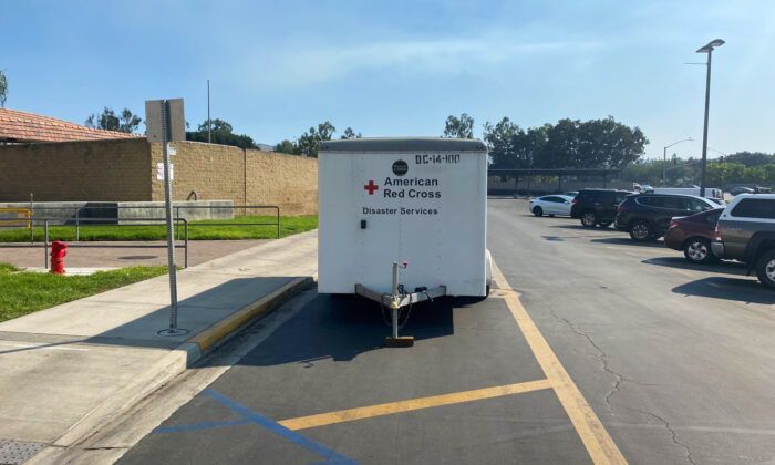 An American Red Cross trailer is parked outside an overnight evacuation center used to house people displaced by the Silverado Fire at University High School in Irvine, Calif., on Oct. 27, 2020. (Jack Bradley/The Epoch Times)