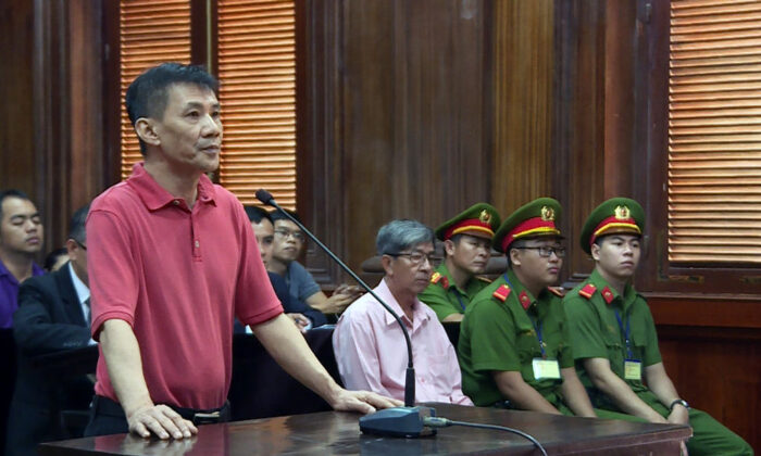 This picture from the Vietnam News Agency was taken and released on June 24, 2019, and shows U.S. citizen Michael Nguyen (L) standing on trial in Ho Chi Minh City, Vietnam. (Vietnam News Agency/AFP via Getty Images)