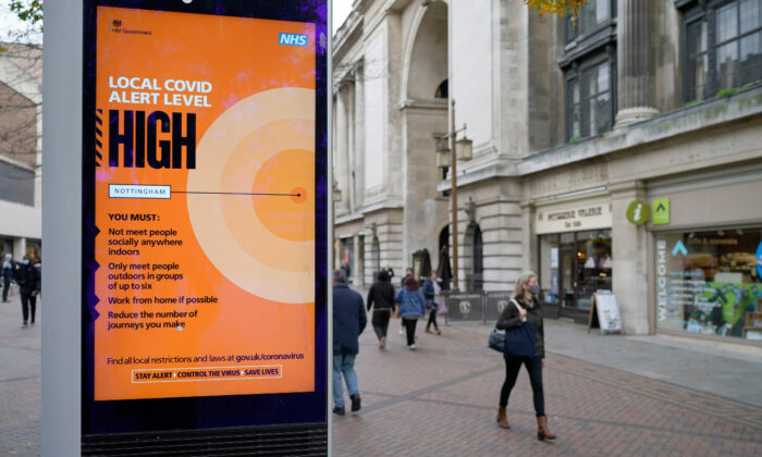 People walk through Nottingham City centre ahead of Tier Three CCP virus restrictions set to take effect in Nottingham on Oct. 28, 2020. On Nov. 5, a national lockdown was enacted to cover the whole of the England. (Christopher Furlong/Getty Images)